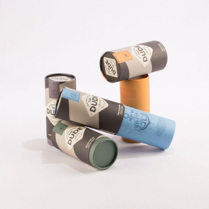 Klädda tuber i papp med tryck