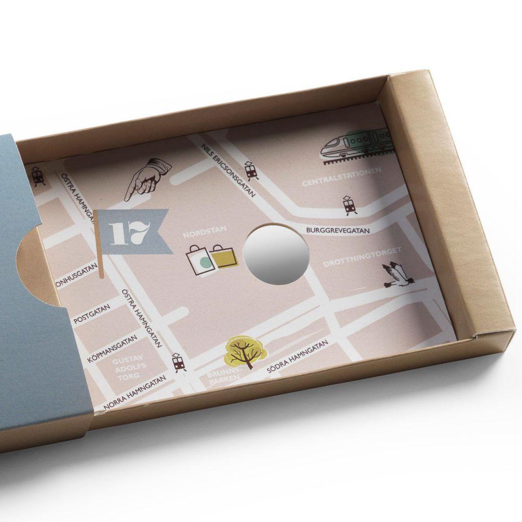Slideförpackning med egen design - här med karta